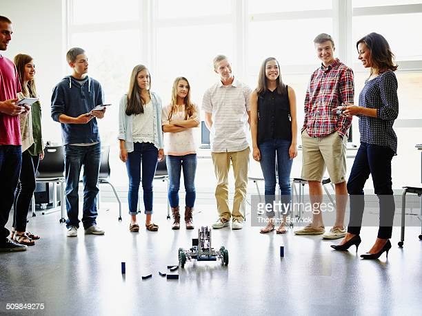 Female teacher leading robotics class