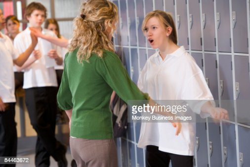Female teacher reprimanding a female student : Stock-Foto