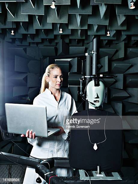 female technician in anechoic chamber
