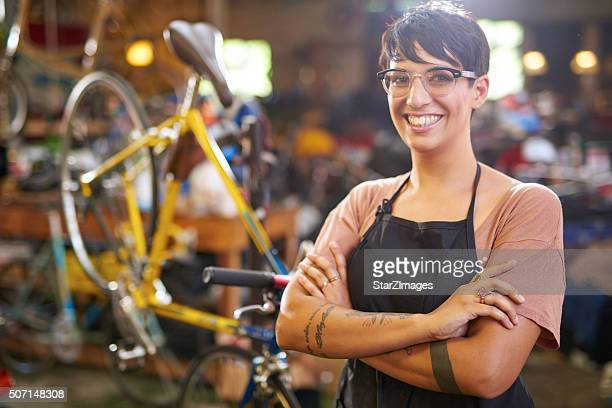 Female technician in her bicycle repair shop