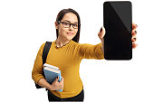 Female teenage student showing a phone isolated on white background