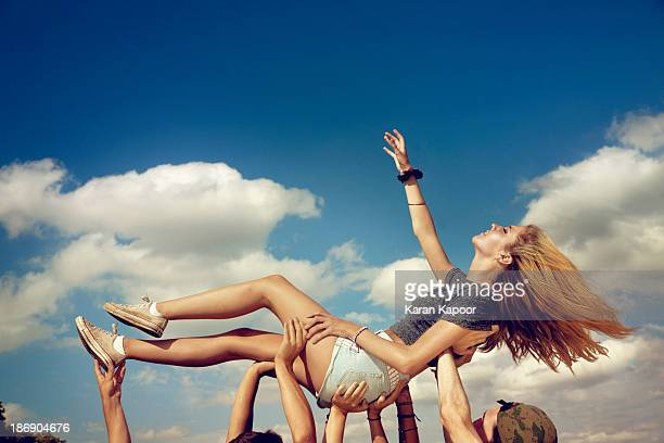 Female teenager held up triumphantly