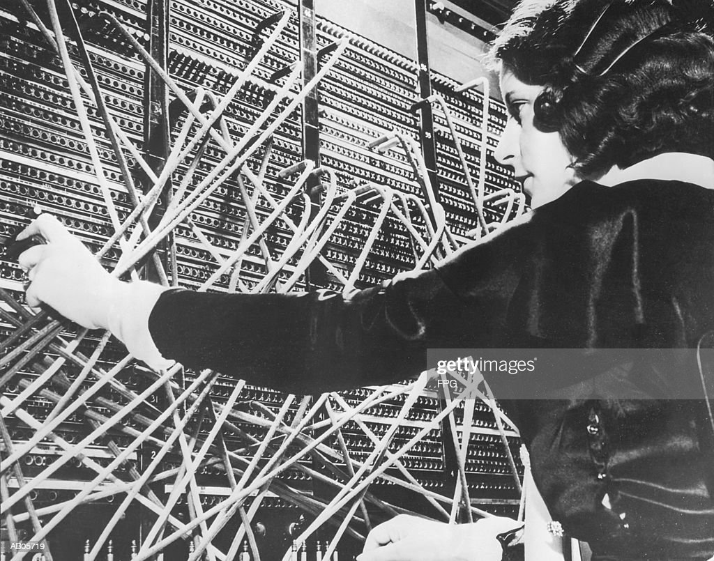 Female telephone switchboard operator connecting caller, close-up (B&W : Stock Photo