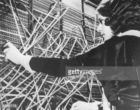 Female telephone switchboard operator connecting caller, close-up (B&W : Stockfoto