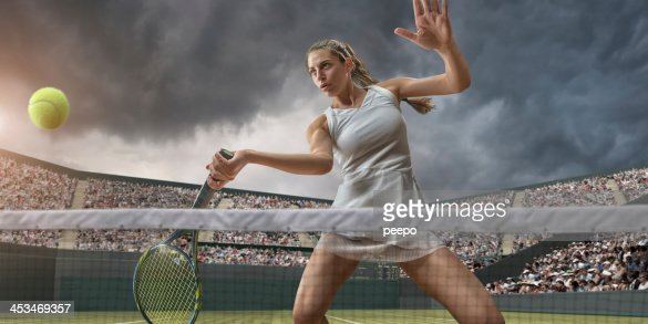 Female Tennis Player About To Strike Ball