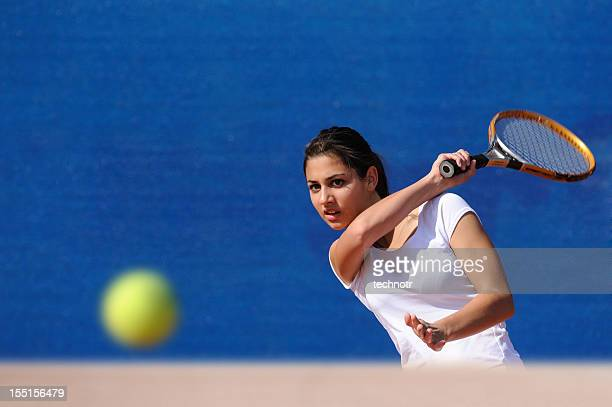 Female tennis player performing forehand drive