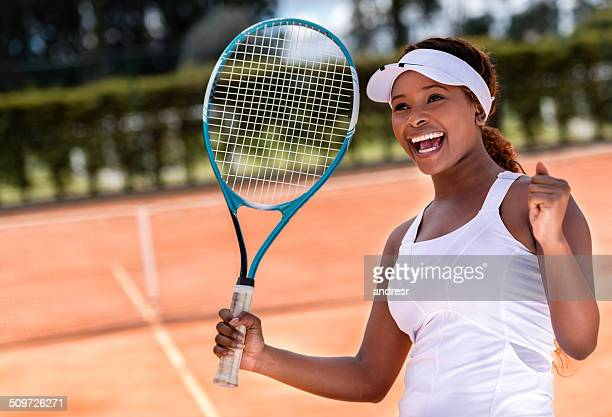 Female tennis player winning