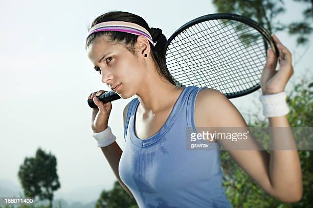 Female Tennis player with a racket.
