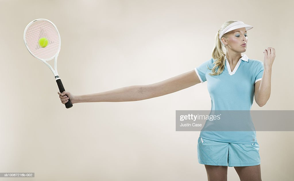 Female tennis player with stretched out arm (Digital Composite) : Stock Photo