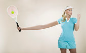 Female tennis player with stretched out arm (Digital Composite)