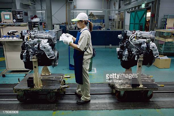 A female Thai worker on the production line at the Auto Alliance automobile plant at the Hemaraj Eastern Seaboard Industrial Estate in Rayong...
