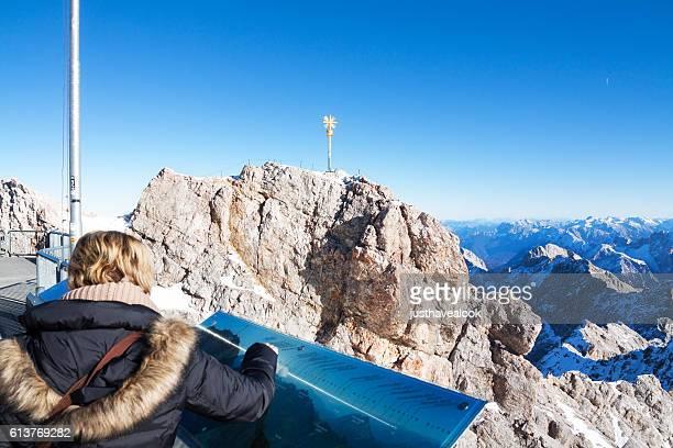 Female tourist at information board on Zugspitze