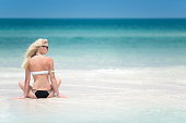 Female Tourist enjoying her Vacation, Perfect Day at the Beach,