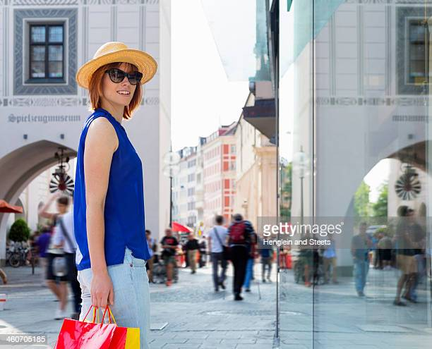Female tourist in Munich Marienplatz, Munich, Germany