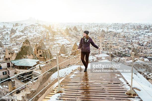Female tourist looking out from viewing platform at Goreme, Cappadocia, Turkey