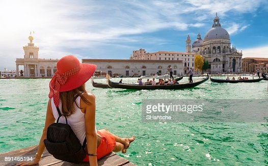 Female tourist looking the Basilica di Santa Maria della Salute and Canale Grande in Venice, Italy : Stock Photo