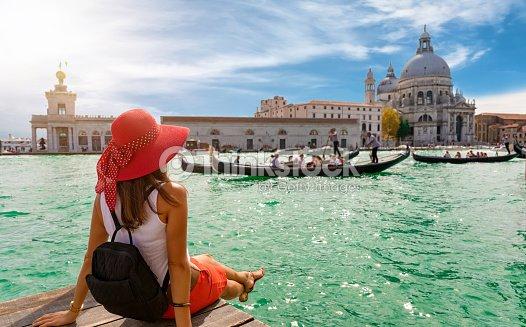 Female tourist looking the Basilica di Santa Maria della Salute and Canale Grande in Venice, Italy : Stock Photo