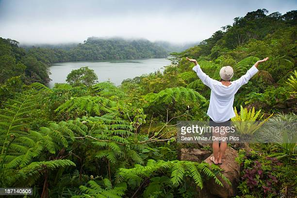 A Female Tourist Stands Among Tropical Plants That Grow Around The Twin Lakes At Twin Lakes National Park
