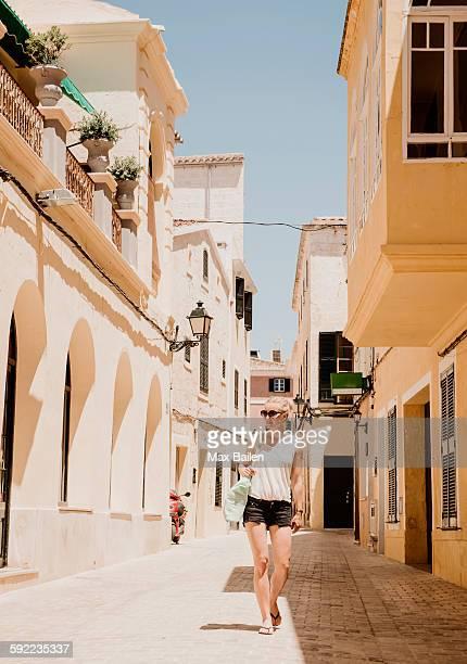female tourist strolling in Ciutadella, Menorca, Spain