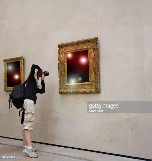 female tourist taking photo in make believe galler