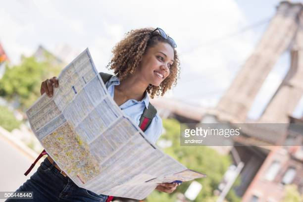 Female tourist with a map in New York