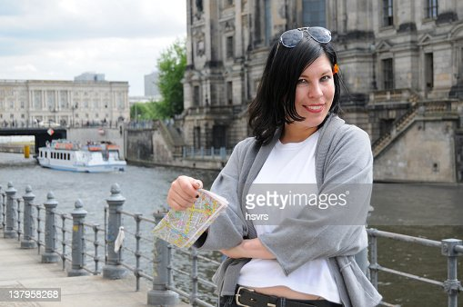 Tourist Looking At Berlin City Map Photo – Berlin City Map Tourist