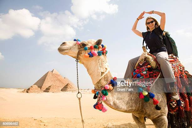 female tourists making pyramid shape with arms sit