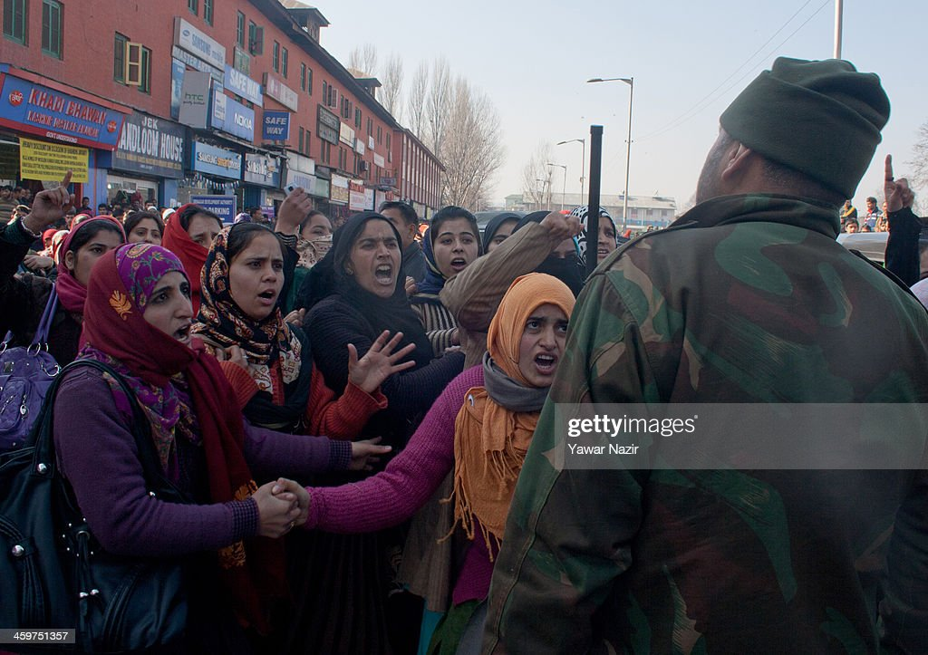 Female trainers (Preraks) employed under Sakshar Bharat Mission, a scheme sponsored by Indian government shout at an Indian policeman during a protest against the government for not paying their salaries on December 30, 2013 in Srinagar, the summer capital of Indian administered Kashmir, India. Dozens of Preraks employed under the scheme, sponsored by the Indian government, were injured after Indian police attempted to disperse the crowd using batons. The group was protesting against the Government for non-payment of their honorarium, due for the last two years.