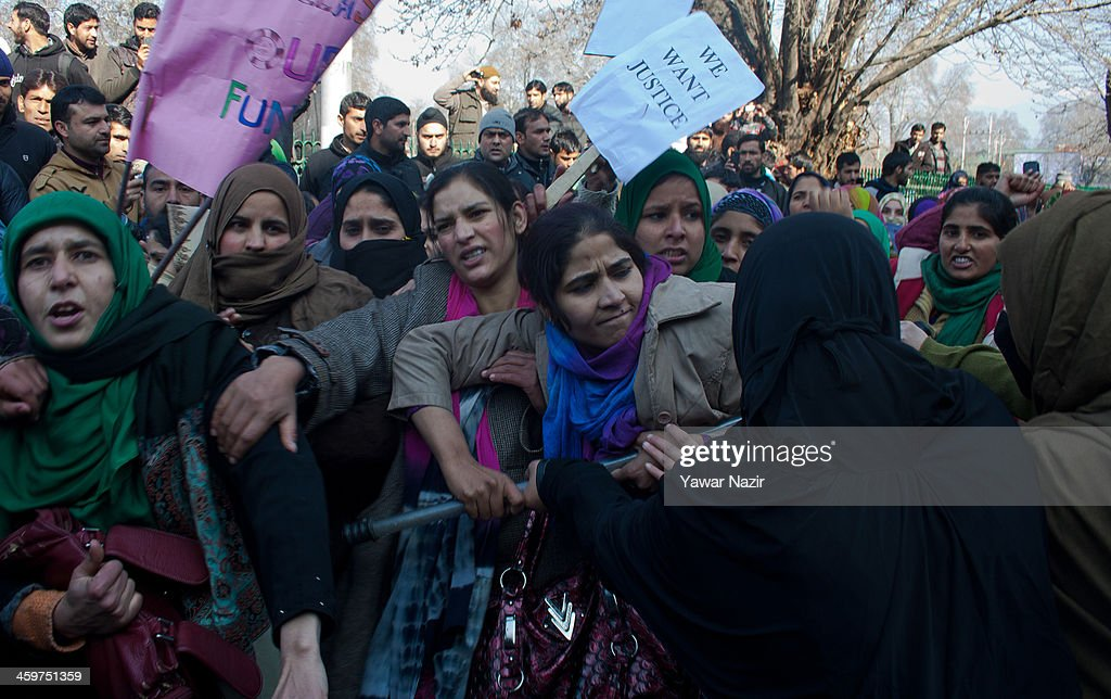 Female trainers (Preraks) (Preraks) employed under Sakshar Bharat Mission, a scheme sponsored by Indian government, scuffle with female Indian police (right) during a protest against the government for not paying their salaries on December 30, 2013 in Srinagar, the summer capital of Indian administered Kashmir, India. Dozens of Preraks employed under the scheme, sponsored by the Indian government, were injured after Indian police attempted to disperse the crowd using batons. The group was protesting against the Government for non-payment of their honorarium, due for the last two years.