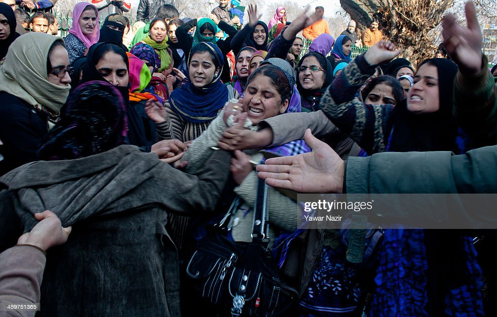 Female trainers (Preraks) employed under Sakshar Bharat Mission, a scheme sponsored by Indian government scuffle with female Indian police (right) during a protest against the government for not paying their salaries on December 30, 2013 in Srinagar, the summer capital of Indian administered Kashmir, India. Dozens of Preraks employed under the scheme, sponsored by the Indian government, were injured after Indian police attempted to disperse the crowd using batons. The group was protesting against the Government for non-payment of their honorarium, due for the last two years.