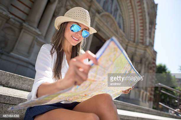 Female traveler looking at a map