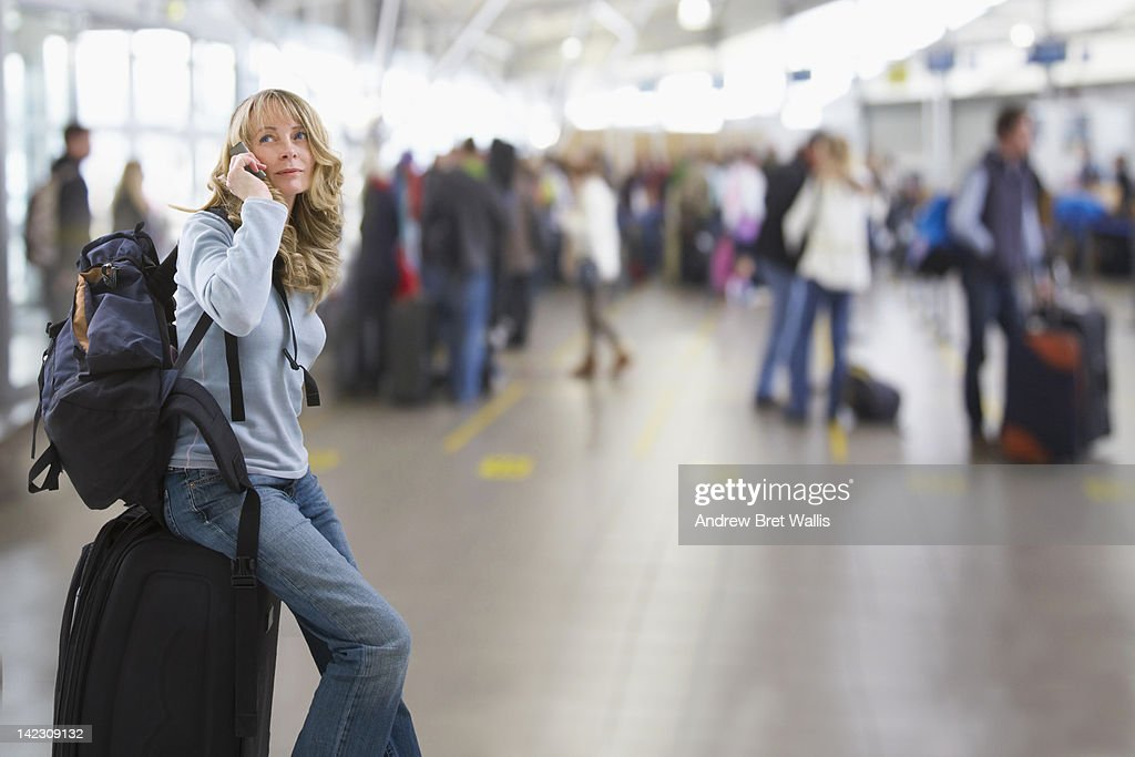 female traveller using a mobile at the airport