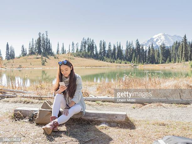 female traveller using cellphone at MT.Rainier