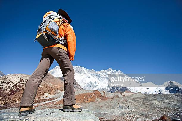 Female trekker looking at Lhotse