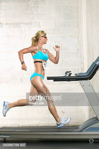 Female triathlete running on treadmill