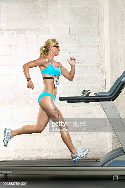 Female triathlete running on treadmill