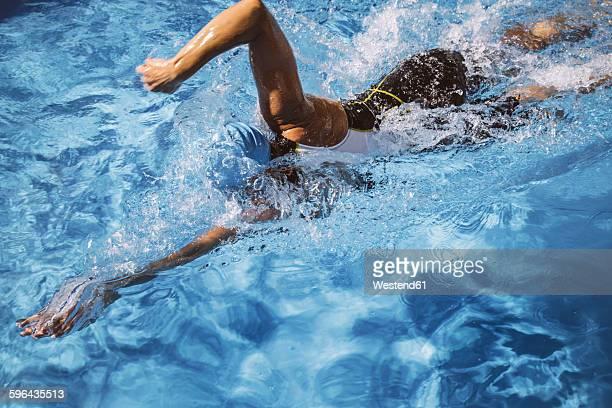 Female triathlete swimming in pool