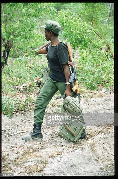 A female UNITA soldier walks down a dirt road January 23 1990 near Jamba Angola The National Union for the Total Independence of Angola and the...