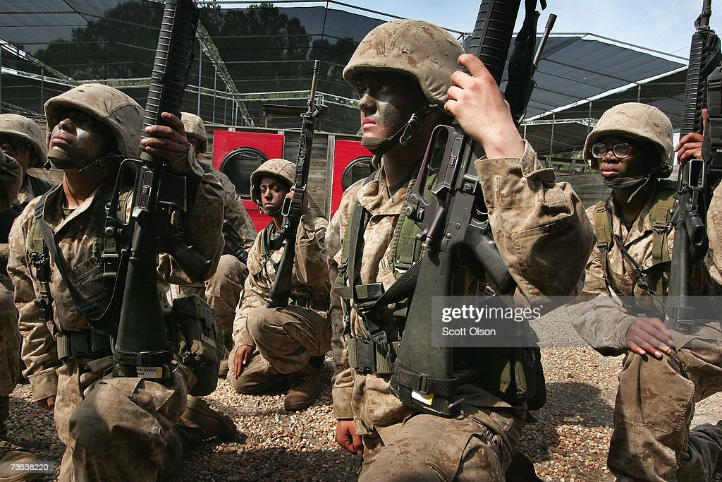Female United States Marine Corps recruits receive instructions for a training exercise during boot camp March 8 2007 at Parris Island South Carolina...