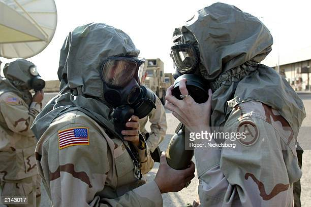 Female US Army soldiers go through a Nuclear Biological Chemical training session January 27 2003 at Camp Doha Kuwait 15 km from Kuwait City In the...
