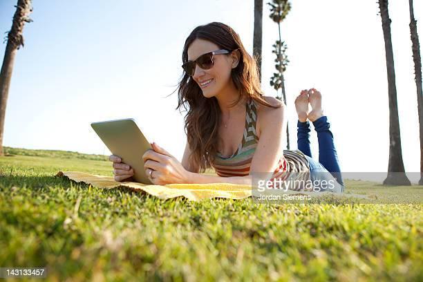 A female using a digital tablet.