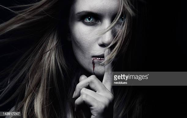 A female vampire with blood dripping