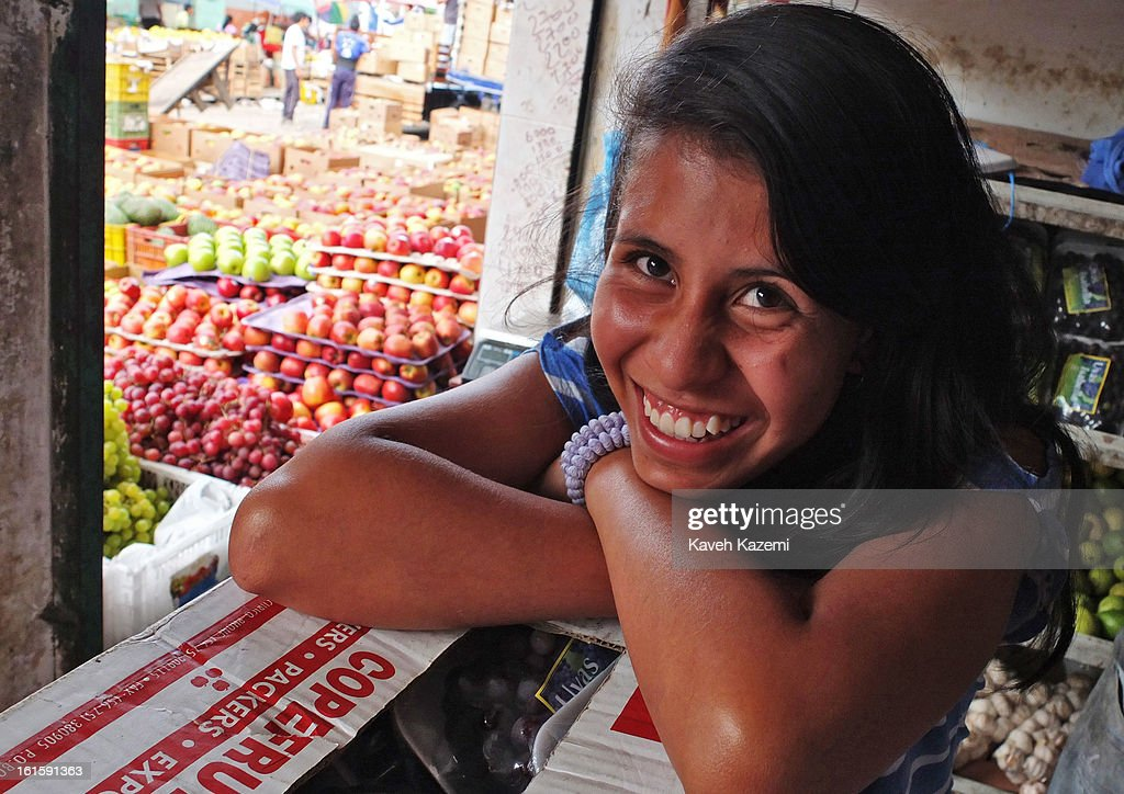 A female vendor smiles in a fruit shop in Barrio Bolivar day market on January 23, 2013 in Popayan, Colombia.