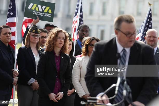 Female veterans look on as Sen Jon Tester speaks during a news conference to introduce the Deborah Sampson Act at the US Capitol on March 21 2017 in...