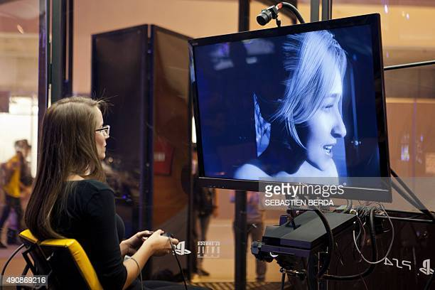 A female videogamer plays on British developer Supermassive Games' interactive horror video game 'Until Dawn' on a PS4 during the Madrid Games Week...