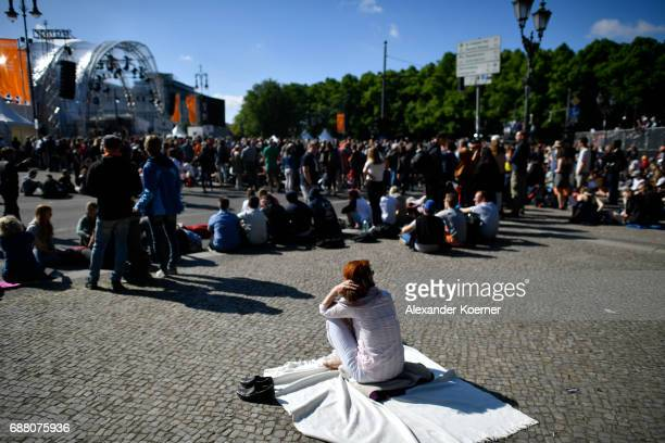 A female visitor rests in the sun during the church congress at Brandenburg Gate on May 25 2017 in Berlin Germany The church day will be held from...