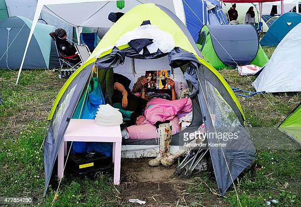 Female visitors take a rest inside their tent at a campsite during the Hurricane Festival 2015 on the morning of June 20 2015 in Scheessel Germany...