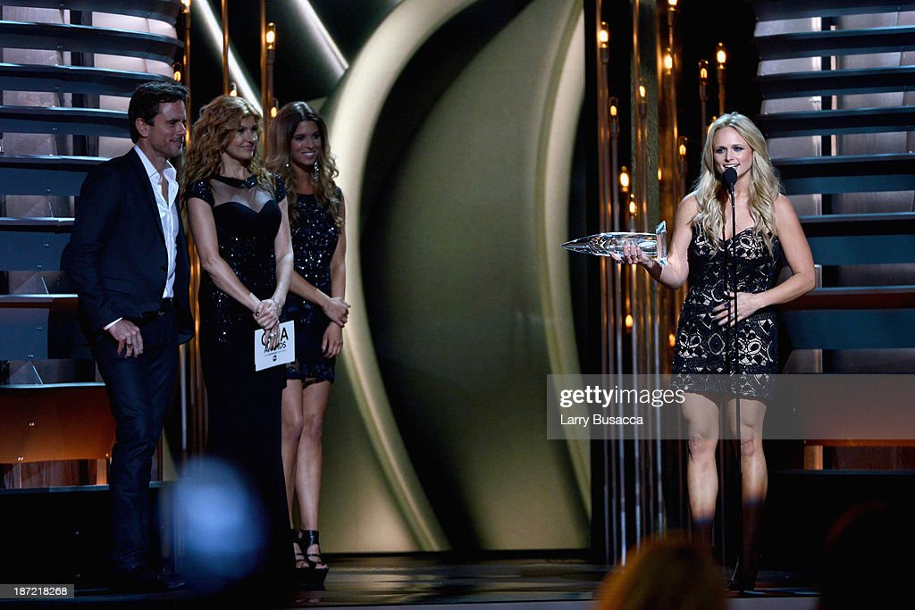 Female Vocalist of the Year Miranda Lambert (L) speaks onstage with Charles Esten and Connie Britton during the 47th annual CMA awards at the Bridgestone Arena on November 6, 2013 in Nashville, United States.