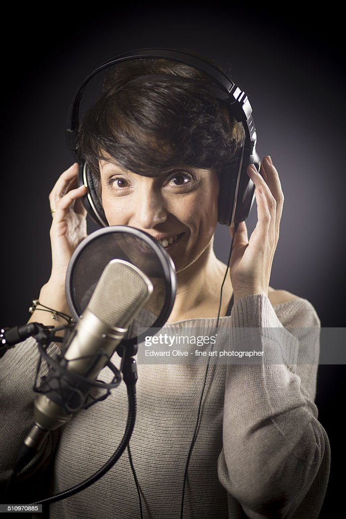 Female voiceover actress in recording studio
