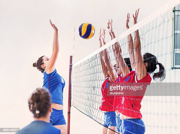 Female volleyball team in action.